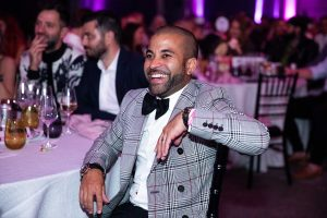 Guests in smart dress smiling and laughing at their tables at the Most Wanted Awards Grand Final 2019