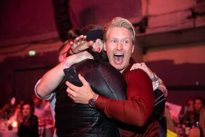 Most Wanted Award for Innovation 2019 winner, Tom Chapman of the Lion's Barber Collective, is embraced by a fellow attendee after his name was announced at the Grand Final in 2019