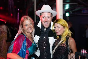 Samantha Grocutt from Essence PR and hairdresser Kenna stand together with another guest at The Most Wanted Grand Final 2019