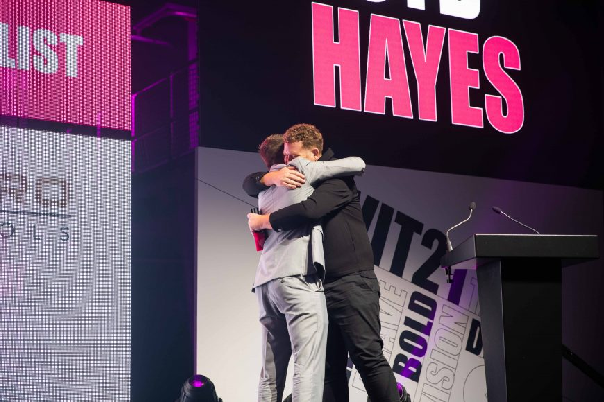 Syd Hayes hugging Sam Johnson