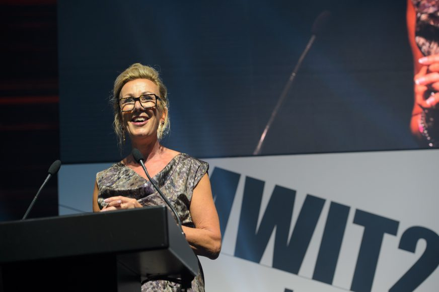 Catherine at lectern