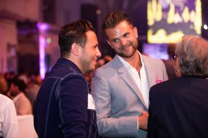 Hairdressers Syd Hayes and Luke Hersheson chat at the bar at the Most Wanted and It List Awards Grand Final 2019